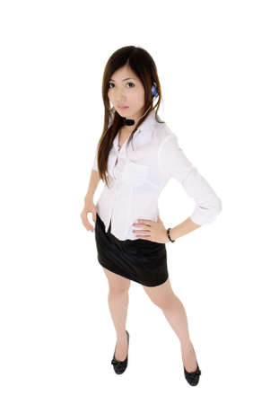 Attractive call center business lady standing, full length portrait isolated over white. Stock Photo - 8401763