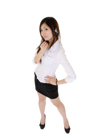 Beautiful business woman with headphone standing, full length portrait isolated over white. Stock Photo - 8401744