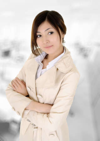 mature adult women: Asian business woman with confident expression on face in office building.