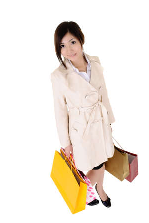 Young lady shopping and holding bags isolated over white. Stock Photo - 8401769