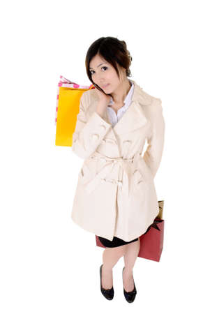 Attractive business woman shopping after working, isolated over white. Stock Photo - 8401765