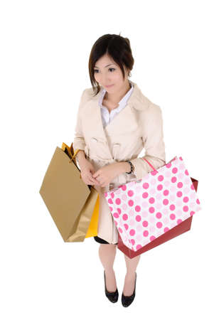 Shopping business woman holding bags and standing, isolated over white bags. Stock Photo - 8401743