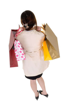 Shopping business woman back, rear view isolated over white background. Stock Photo - 8401772