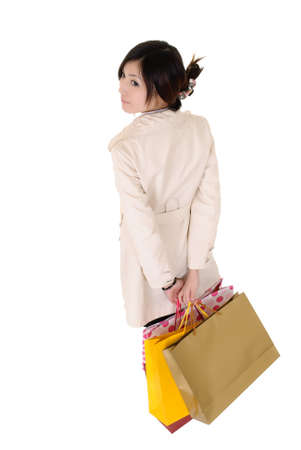 Attractive shopping woman holding bags and watching isolated over white. Stock Photo - 8401770