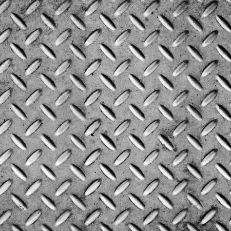 Background of metal diamond plate in silver color. Stock Photo - 8401888