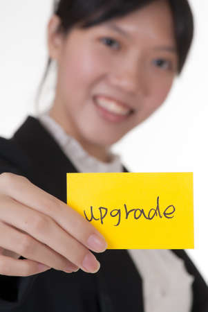 Upgrade on business card holding by Asian businesswoman. photo