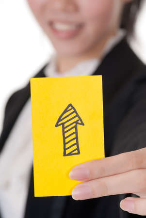 denote: Up arrow on business card holding by Asian businesswoman.