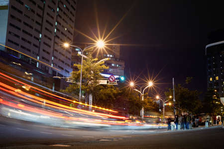 avenues: City night scene with cars motion blurred in Taipei, Taiwan, Asia.