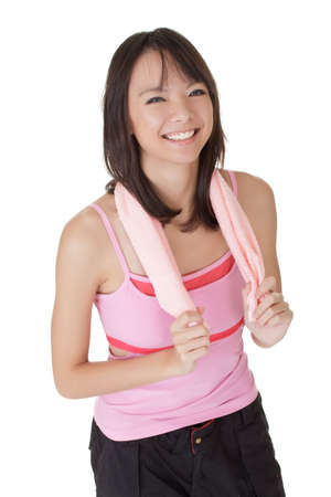 Happy fit girl of Asian smiling over white background. Stock Photo