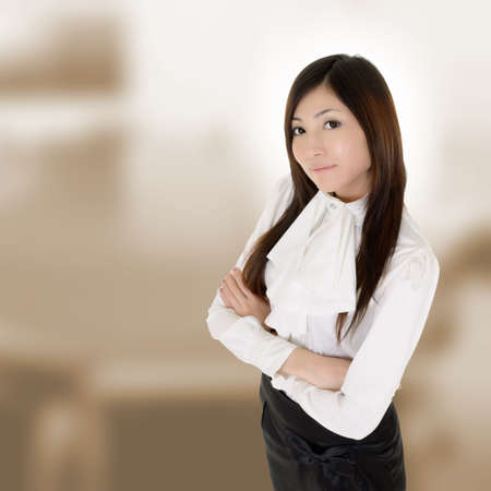 Attractive modern executive of Asian woman in business building. Stock Photo - 8436173