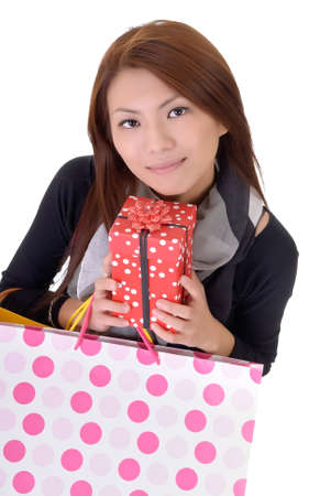Young attractive woman holding bags over white. photo