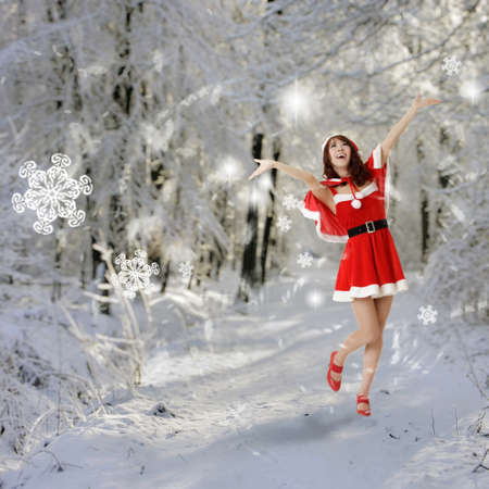 Happy Christmas woman open arms in snow forest. photo