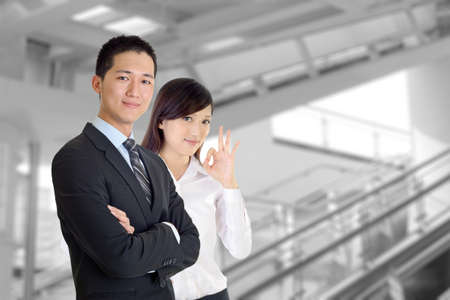 Business team, smiling businessman and friendly businesswoman in modern building. Stock Photo - 8453373