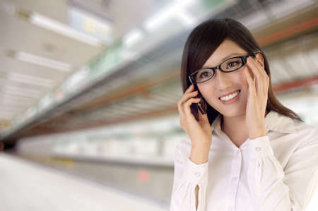 Attractive business woman using cellphone in train station. photo
