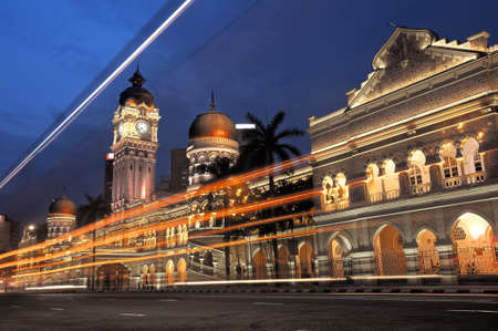 Colorful city night scene with cars motion blurred in Kuala Lumpur, Malaysia, Asia.