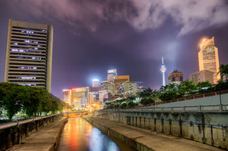 Modern city night scenery with colorful buildings and towers in Kuala Lumpur, Malaysia, Asia. photo