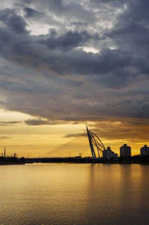 Sunset bridge under dramatic sky in Putrajaya, Malaysia, Asia. photo