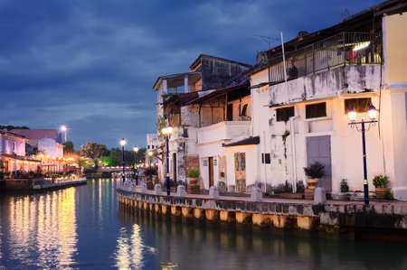 dwell: Malacca city night with house near river under blue sky in Malaysia, Asia. Stock Photo