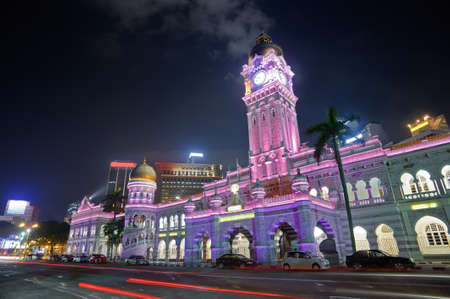 Colorful city night with famous landmark, Sultan Abdul Samad Building, in Kuala Lumpur, Malaysia, Asia. photo