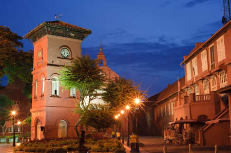 Malacca landmark, Stadthuys Square, with clock tower and old red house in night in Malaysia, Asia. photo