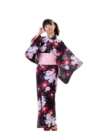 Young japanese girl in traditional clothes, full length portrait isolated on white. Stock Photo - 8801236
