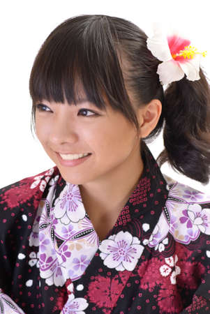 Happy Japaneses girl with cheerful expression and smiling on white background. photo