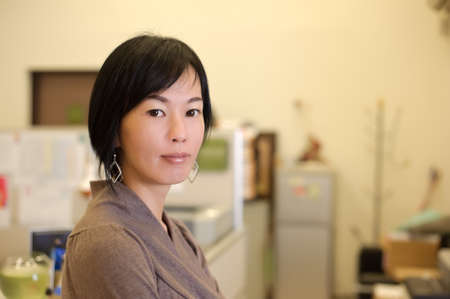 Mature business woman of Asian, closeup portrait in office. Stock Photo - 8801285