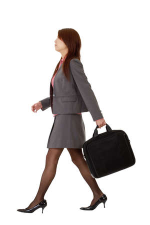 Business woman walking, full length pose isolated on white background.