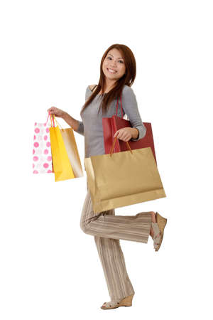 Shopping woman with bags on hand with glade expression on face.
