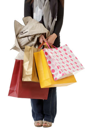 Shopping woman holding colorful bags on hand and standing over white background. Stock Photo - 8801286