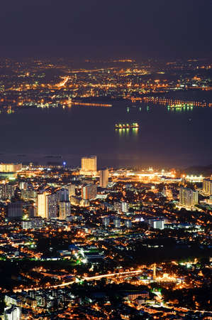 penang: City night with golden buildings in Penang, Malaysia, Asia.