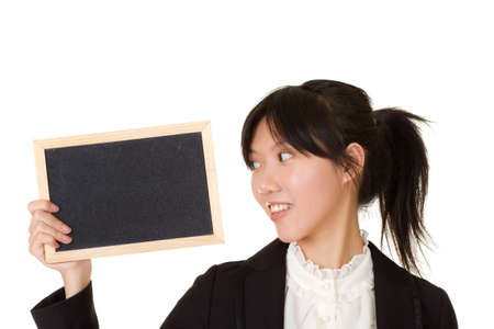 Young woman holding blank blackboard and watching it over white background. photo