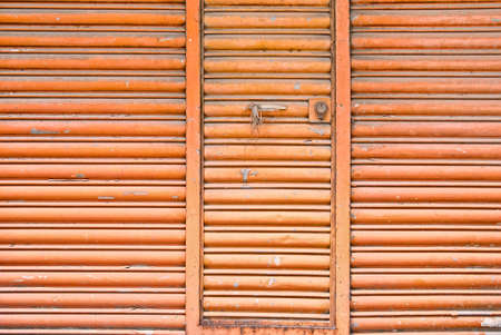 Old and grunge metal wall with closed door. photo