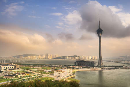 Urban landscape of Macau with famous traveling tower under blue sky near river in Macao, Asia. Stock Photo - 8797318