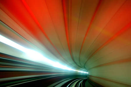 colorful scene of tunnel in the fast moving of the subway. photo
