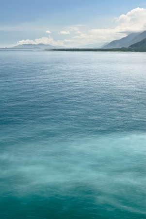 cloud drift: Background of blue water of ocean in daytime. Stock Photo