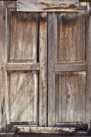 Old door of wooden was closed with grungy style. photo