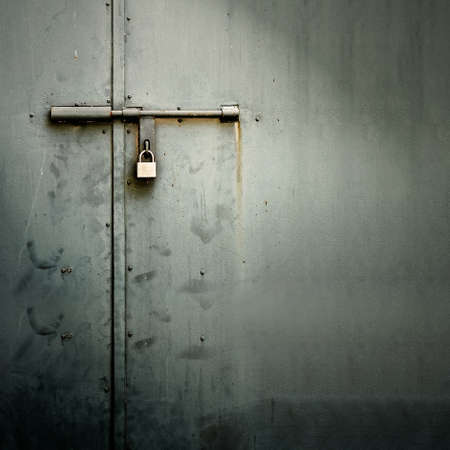metallic grunge: Closeup metal door with lock in grungy style and good texture.