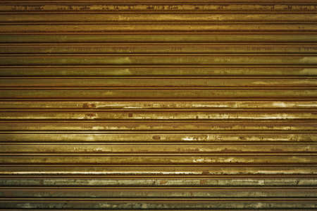 Background of old metal door in grungy style. photo