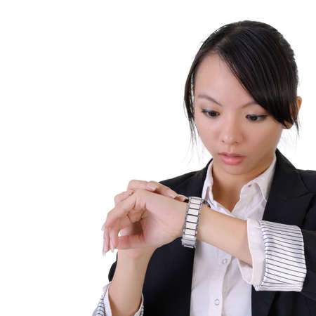 Business woman looking watch with surprised expression, closeup portrait with white copyspace. photo