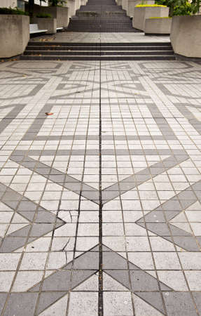 Tiles and step with geometric patterns in gray photo