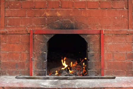 Chinese temple of fire burning in the brick stove. photo