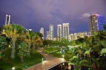 lumpur: Night scene of modern city with park in Kuala Lumpur, Malaysia, Asia. Stock Photo