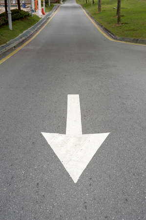 backwards: Down or backwards to drive towards the marker on the road.