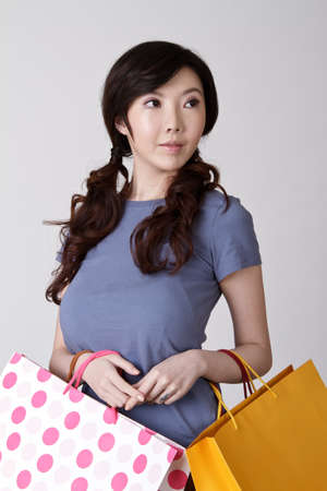 Elegant Shopping woman of Chinese, closeup portrait with attractive expression. Stock Photo - 8952084