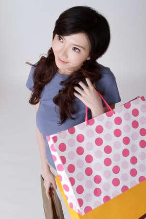 Shopping woman looking, closeup portrait of Asian beauty. Stock Photo - 8952086
