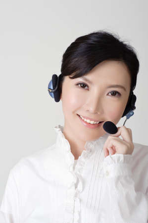 Smiling business woman with headphone, closeup portrait. photo
