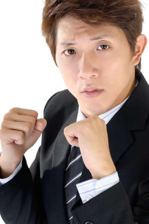 Young executive fight pose, closeup portrait of Asian business man. Stock Photo - 8953015
