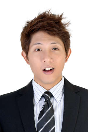 Surprised expression on young Asian executive, closeup portrait. photo