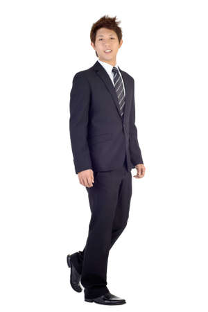 Happy smiling business man walking with smiling expression, full length portrait isolated over white background.